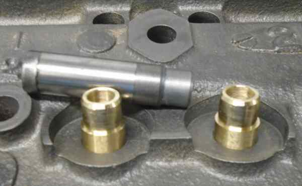 """A previous shop installed bronze helical type screw in guide liners and positive stem seals, but didn't top off the guides for the difference in seal height. All of the stem seals were smashed by the retainers because the only available cam is a higher lift """"RV"""" type with .500+ lift. They obviously didn't check for proper clearance. The factory guides are replaceable, so Tuf-Enuf installed the solid bronze type guides."""